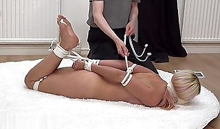 gorgeous german blonde put off by gagged added to hogtied