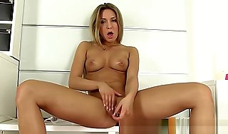 Lubricated peach beautie strokes her clit