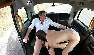 Hot brunette leafless in a taxi