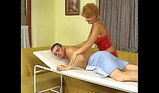 Young Man Gets a Kneading From a Redhead MILF