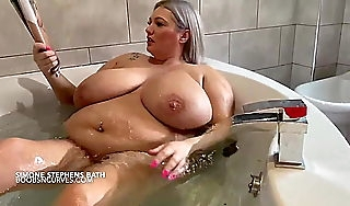 Wellendowed British Milf reads a porn mag not far from the bath